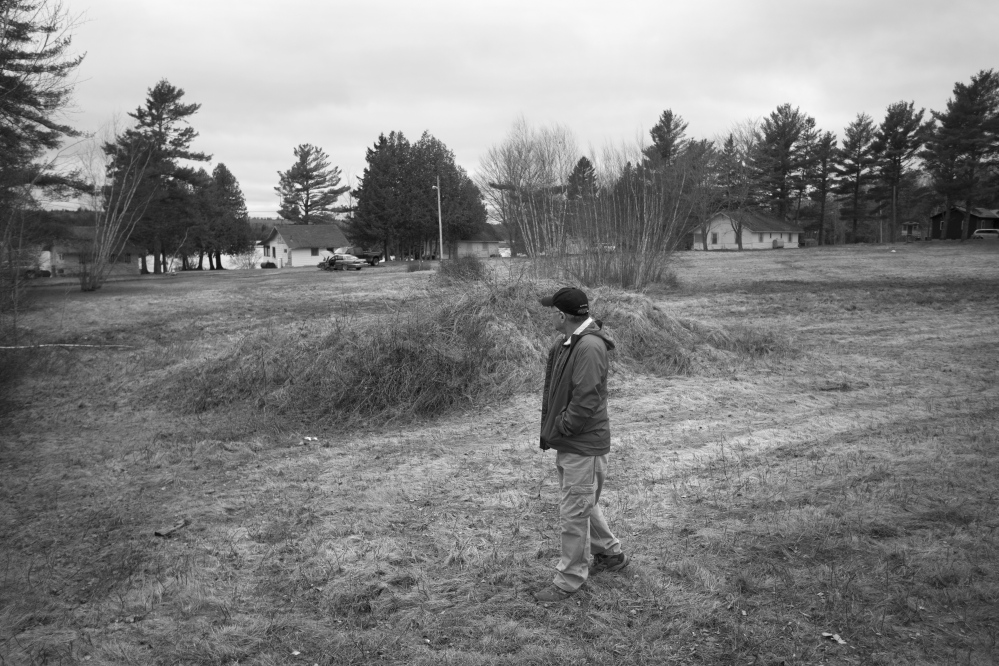 Passamaquoddy historian Donald Soctomah walks past a weed-covered gravel pile just off Route 1 in Indian Township, where a handful of Indians sat in protest 50 years ago, stopping a white man from building a road on reservation land, and starting a chain of events that would alter the course of history.