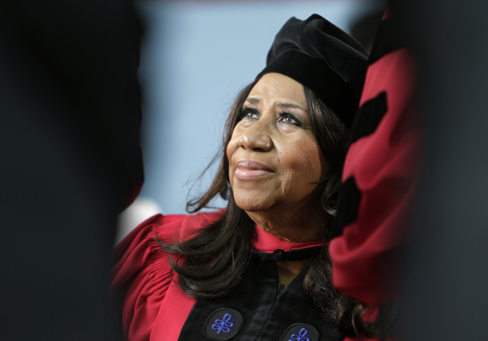 Singer Aretha Franklin looks up while seated on stage during Harvard University's commencement ceremonies in Cambridge, Mass., where she was presented an honorary Doctor of Arts degree on May 29, 2014.