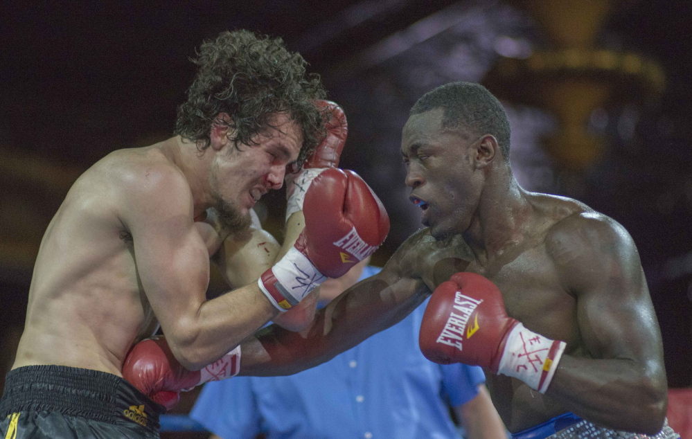 Russell Lamour of Portland, right, won a unanimous decision Saturday night against Saul Almeida of Framingham, Mass., but wasn't happy with his performance.