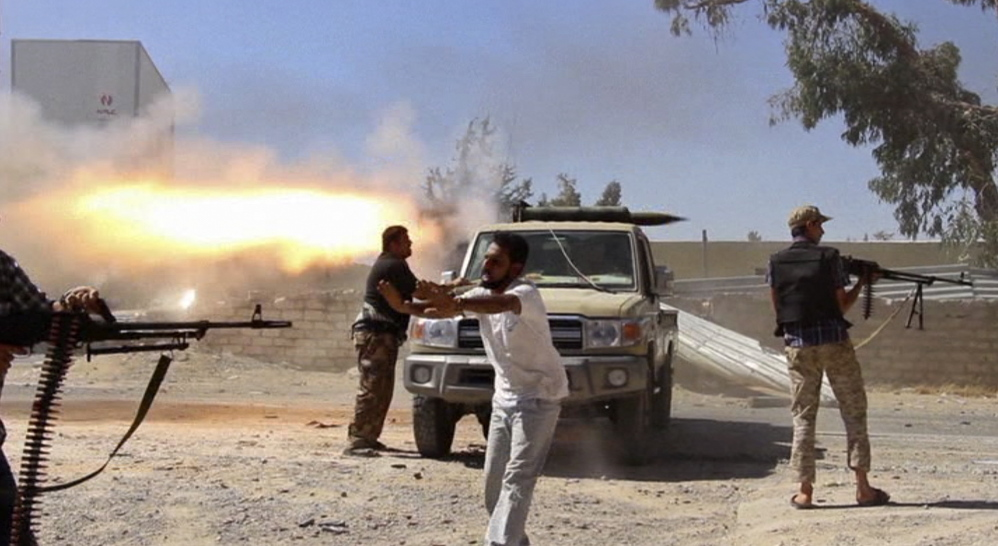 In this frame grab from a freelance journalist's video, fighters from the Islamist Misarata brigade fire toward the Tripoli airport Saturday in an attempt to wrest control from a rival militia. The battle for the airport has killed 79 and wounded 400.