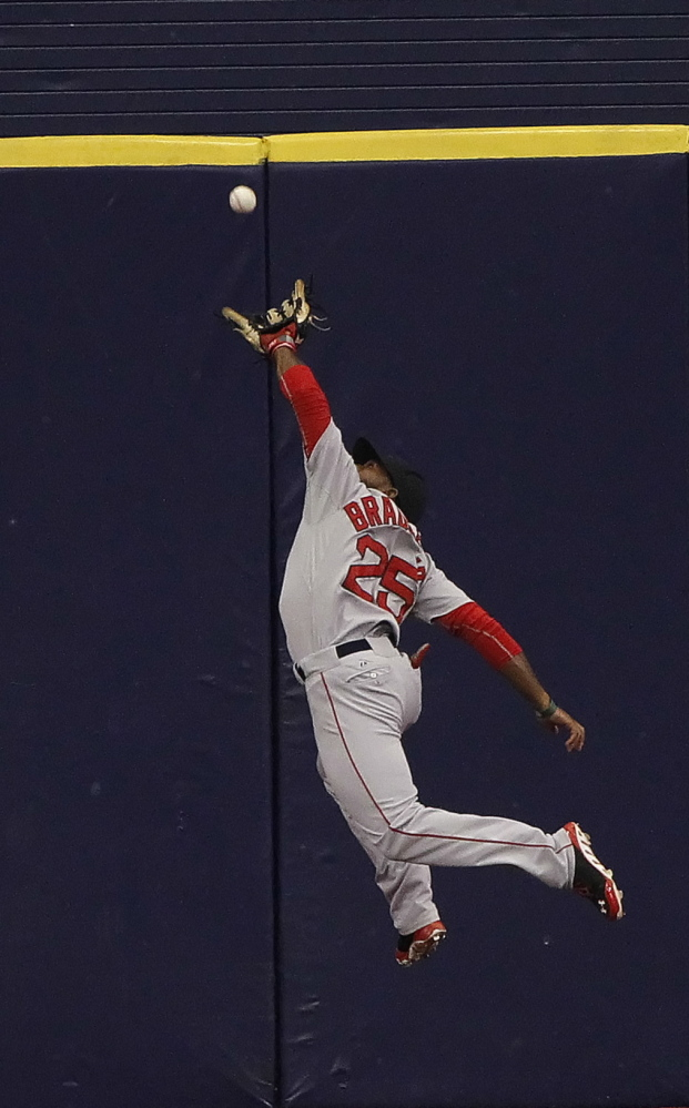Red Sox center fielder Jackie Bradley Jr. makes a leaping catch on a drive by Tampa Bay's Evan Longoria in the sixth inning, helping Boston end a five-game losing streak.