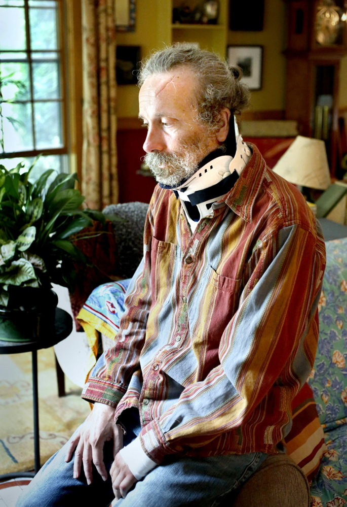 About a month after he was attacked by a polar bear in Canada, Matt Dyer recounts the ordeal in August 2013 while wearing a neck brace at his home in Turner.