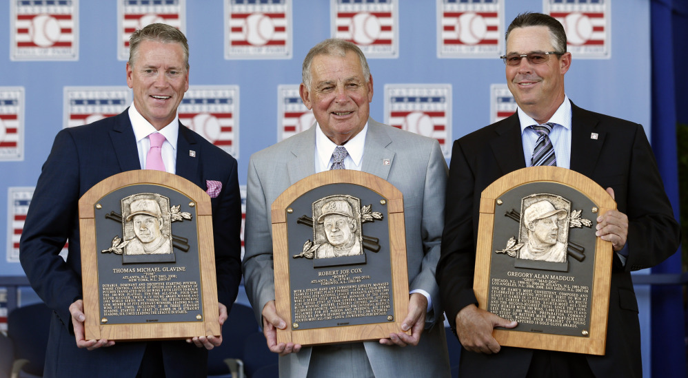 It was a reunion of Atlanta Braves greats as pitchers Tom Glavine, left, and Greg Maddux, right, along with their manager, Bobby Cox, were inducted into the baseball Hall of Fame on Sunday in Cooperstown, N.Y.
