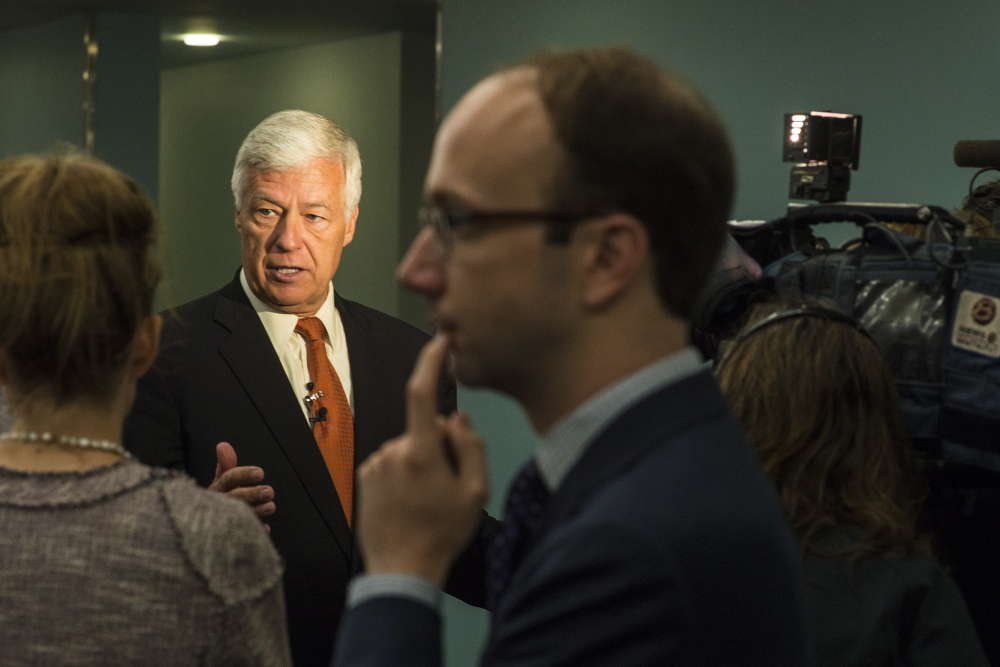 U.S. Rep. Mike Michaud, Maine's Democratic candidate for governor, answers questions from reporters before the Democratic National Committee rally on Monday.