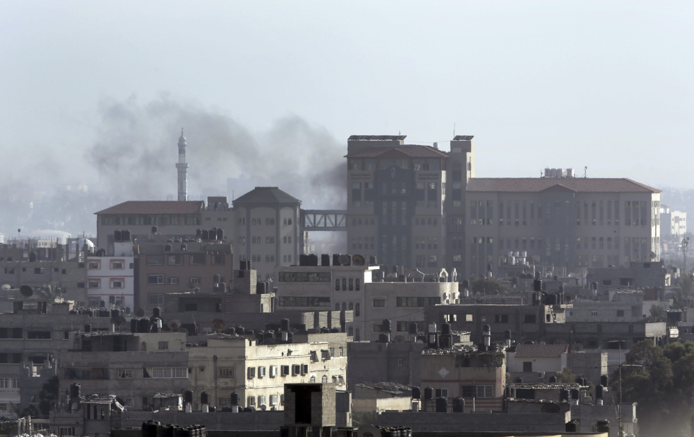 Smoke from an Israeli strike rises over a building in Gaza City in the northern Gaza Strip on Sunday.