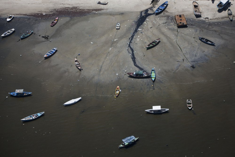 In this Nov. 19, 2013 photo small boats sit on the shore of Guanabara Bay in the suburb of Sao Goncalo, across the bay from Rio de Janeiro, Brazil.
