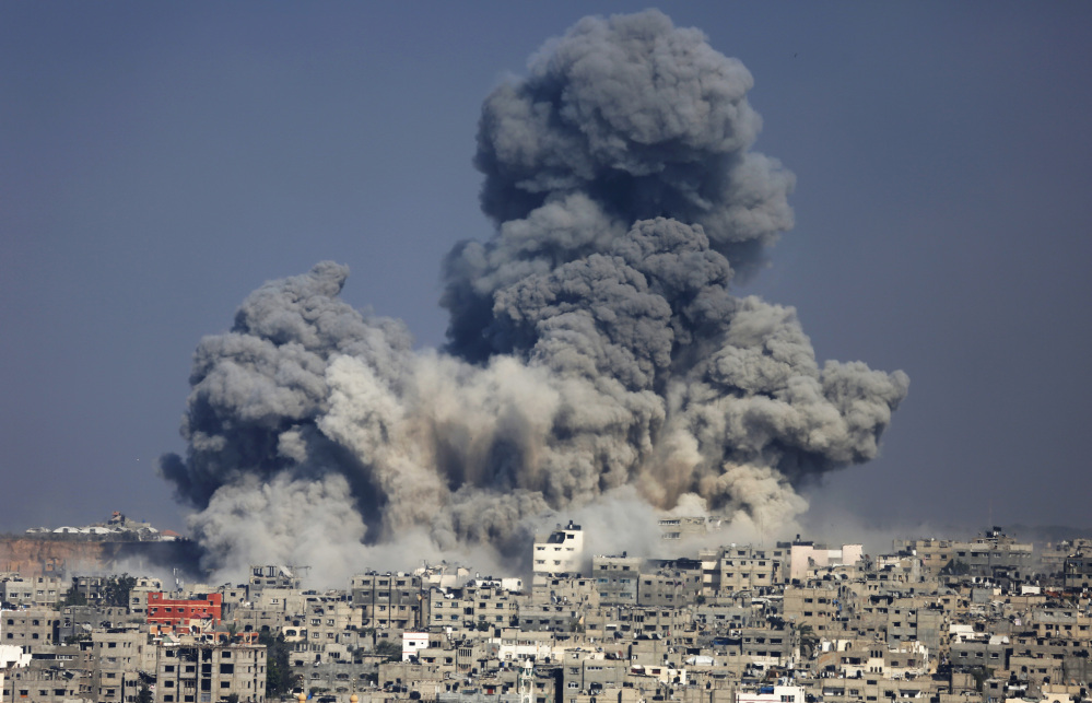 Smoke from the explosion of an Israeli strike rise over Gaza City, Tuesday.