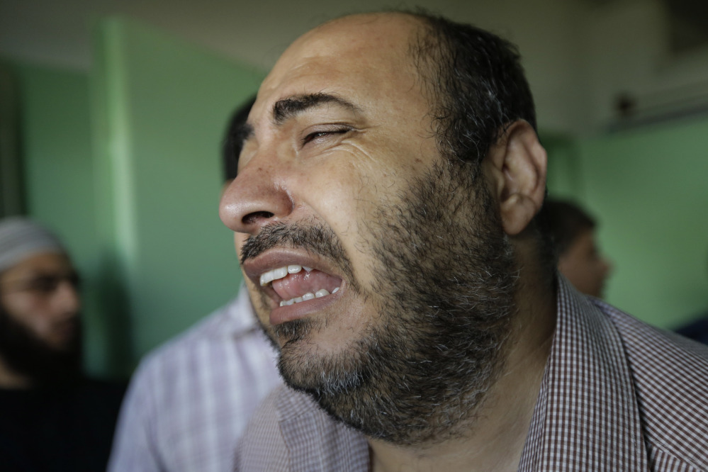 "A Palestinian relative of a person who was wounded in an Israeli strike in Jebaliya refugee camp in the northern Gaza Strip cries as he exits the emergency room at the Kamal Adwan hospital in Beit Lahiya on Tuesday. Israeli Prime Minister Benjamin Netanyahu said Monday that Israel must be ready for a ""prolonged"" military operation in the Gaza Strip."
