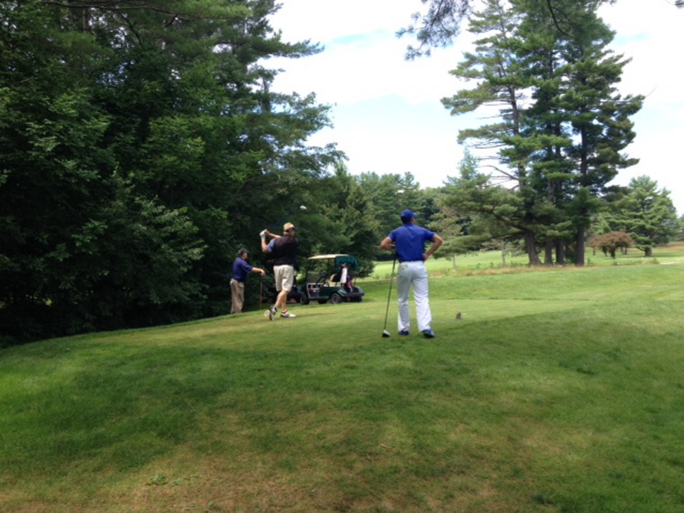 Eric Egloff tees off during the annual Charlie's Maine Open on Tuesday morning. Staff photo by Evan Crawley