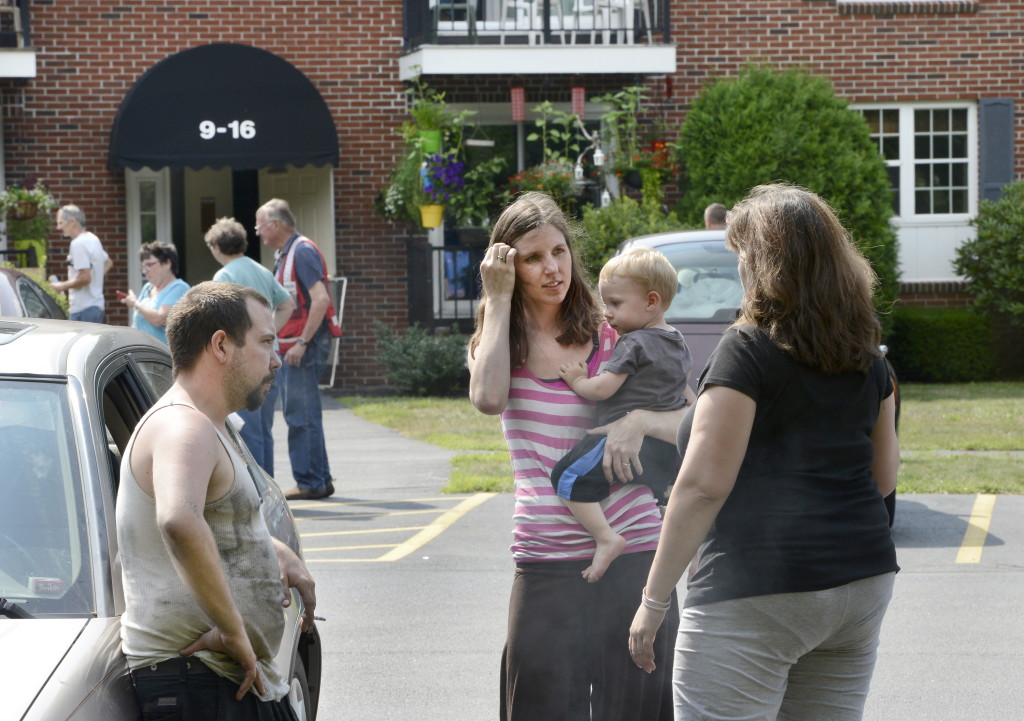 James Dolloff, Dawna Rousseau and their son 22-month-old son, Thorian Dolloff, are looking for new housing after a fire Wednesday night that displaced 45 people at the Dolley Brook Condominiums in Westbrook .
