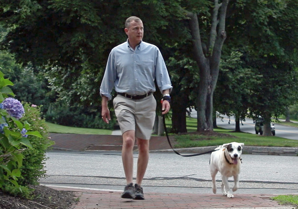 Bill Feldman walks his dog Henry using the hands-free leash wristband he invented. Photos by Amelia Kunhardt/Staff Photographer