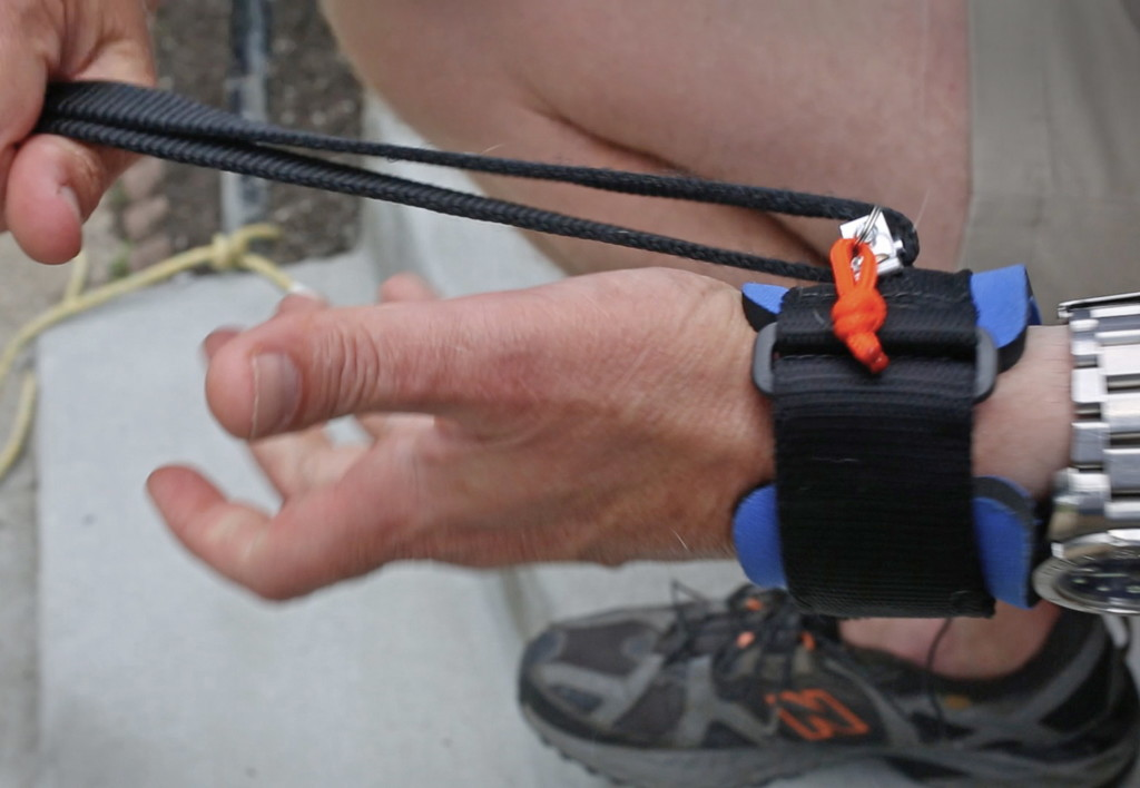 The device allows users to hold a phone or other object in their hands while their dog's leash stays attached to a wristband.
