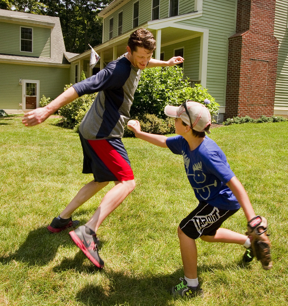 McCarthy dodges a tag from Cal Hodgdon while playing pickle the Charron family's Falmouth yard.