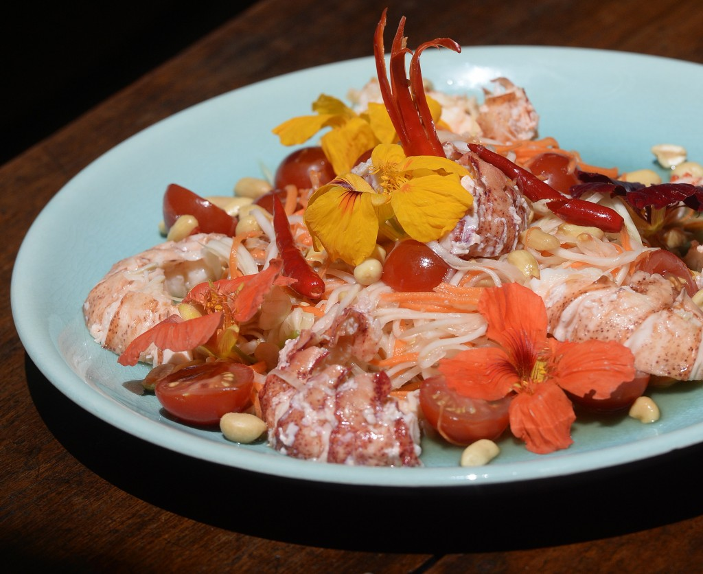 Green papaya and carrot salad served with Maine lobster.