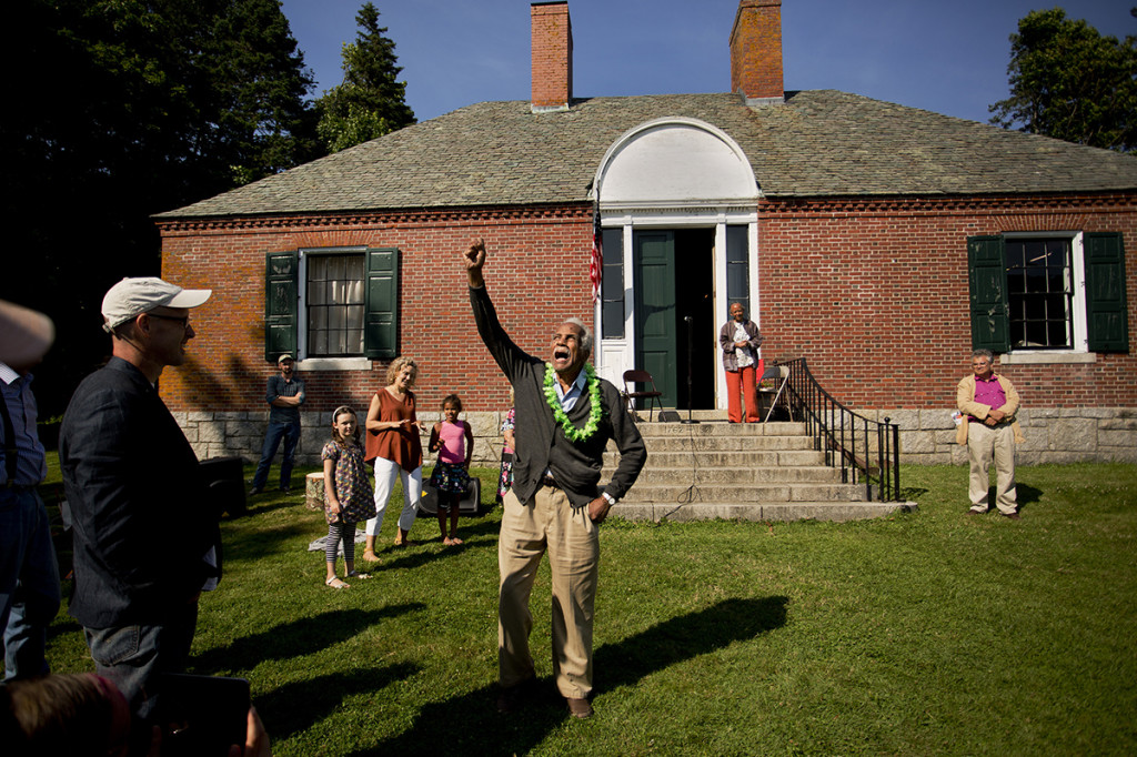 Bryan lets out a yell while reciting a poem to a gathered crowd at the Isleford Historical Museum. The event was to celebrate the opening of the Ashley Bryan Center inside the museum, which celebrates Brown's hear 80-year career as an artist.