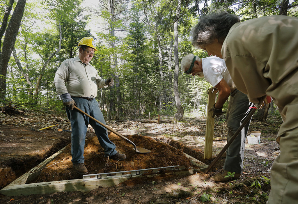Lester Kenway, left, works with his wife Elsa Sanborn and Craig Dickstein while constructing a handicapped accessible privy on a section of the Appalachian Trail where it crosses the Kennebec River in Caratunk.