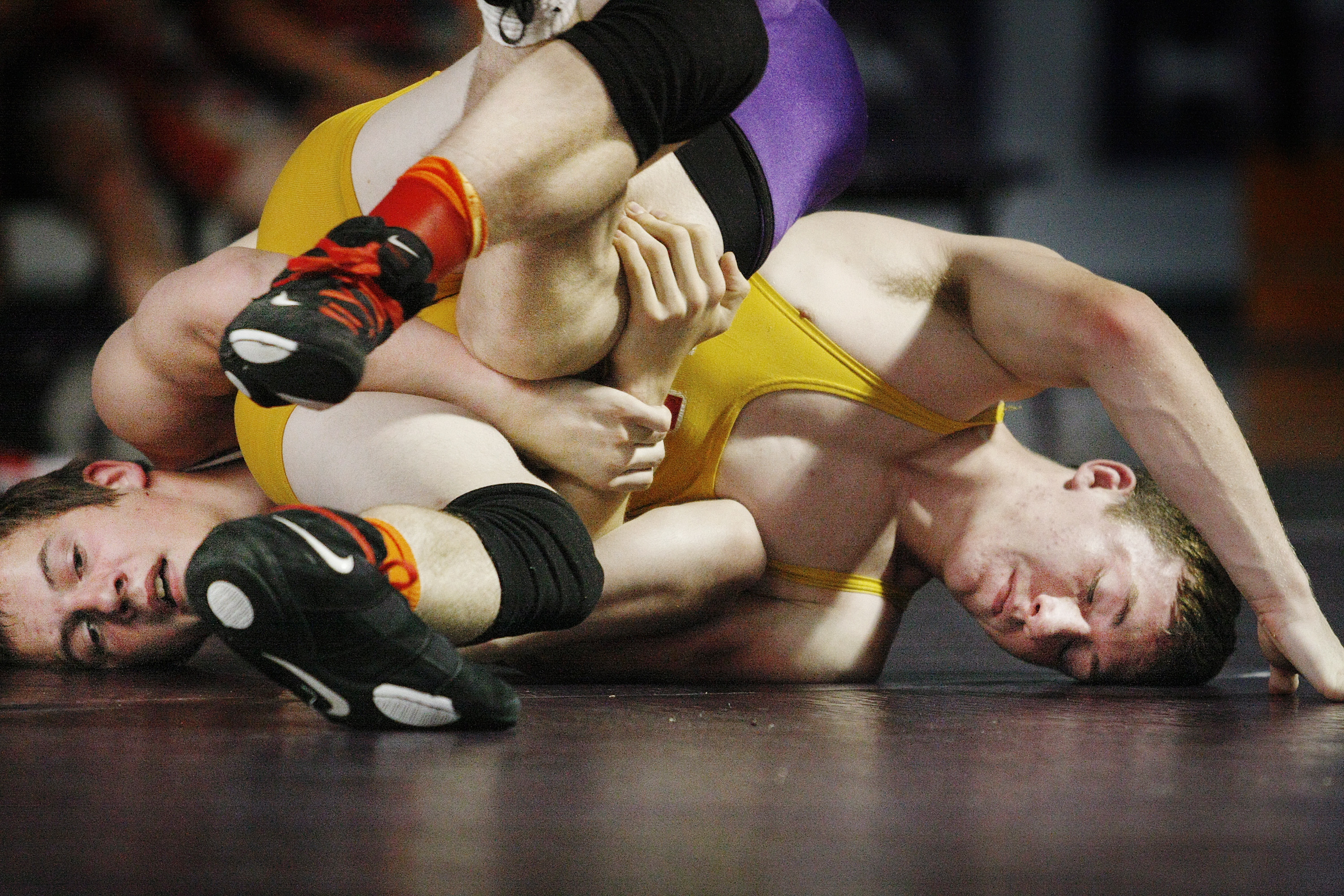 Bradley Beaulieu of Marshwood, left, tangles with Jonathan Fletcher of Nebraska as all-star wrestlers from Maine and Nebraska meet in a match at Marshwood High School Tuesday in South Berwick.  Jill Brady / Staff Photographer