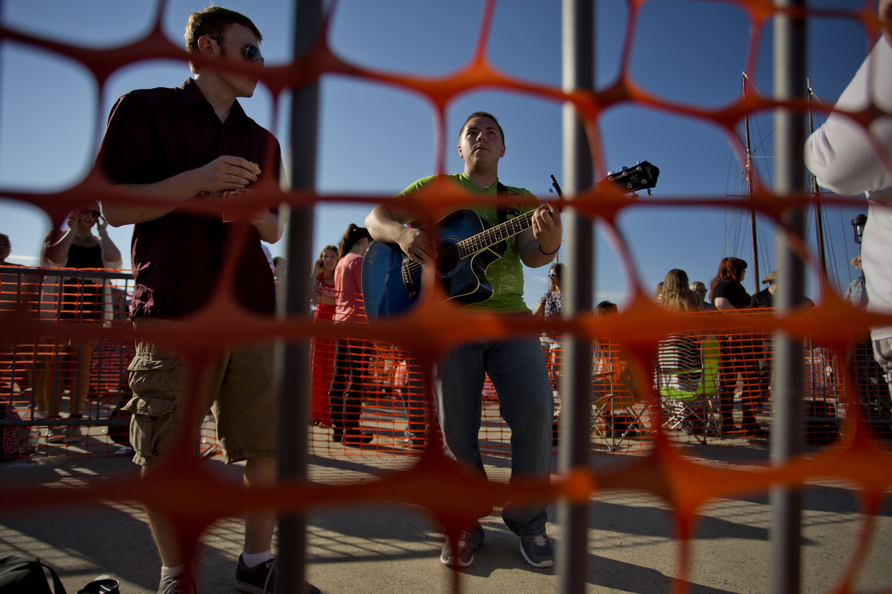 Ben Cooper, 18, of Hollis, N.H., at left, waits in line with Andrew White, 17, of Waite, while he plays guitar, as they two wait to audition for American Idol.