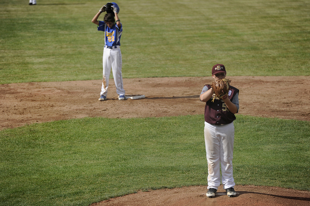 Saco's Pat Sawyer pitches with Falmouth's Justin LeFevre on second base at the Hill Street Field on Thursday, July 24, 2014. (Photo by Logan Werlinger/Staff Photographer)