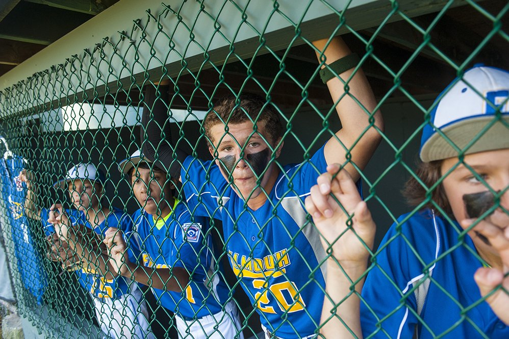 Connor Coffin (from left), Andy Arnoldo, Brady Douglas, and Jackson Quinn watch their team bat against Saco at the Hill Street Field on Thursday, July 24, 2014. (Photo by Logan Werlinger/Staff Photographer)