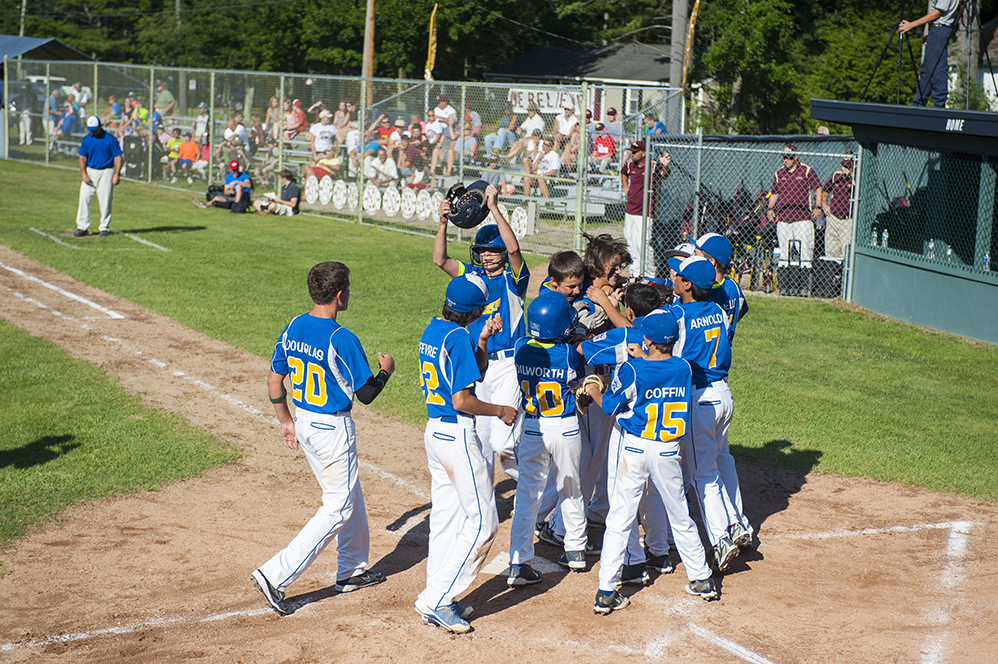 Falmouth celebrates a Jackson Quinn homerun at the Hill Street Field on Thursday, July 24, 2014. (Photo by Logan Werlinger/Staff Photographer)