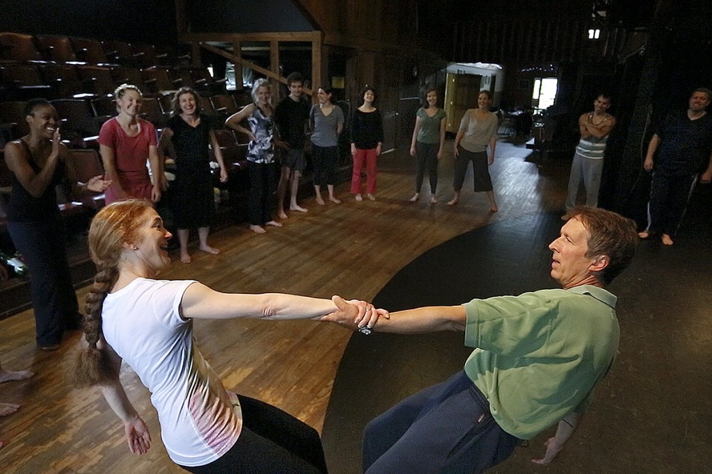 Karen Montanaro, an instructor in the devising intensive workshop at the Celebration Barn Theater in South Paris, and Davis Robinson, also an instructor, show students how to share weight with one another while performing physical theater. Montanaro's former husband Tony Montanaro was a world famous mime and founded the barn in 1972 as a teaching ground for artists from around the world.
