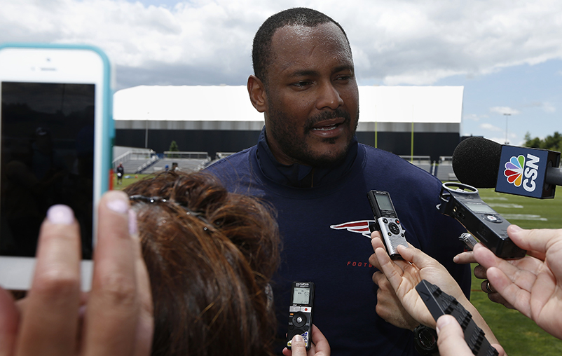 New England Patriots linebacker Will Smith talks with reporters following NFL football mini-camp in Foxborough, Mass., Wednesday. The Associated Press