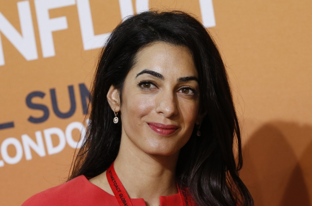 Amal Alamuddin, human rights lawyer and fiancee of U.S. actor George Clooney, attends the 'End Sexual Violence in Conflict' summit in London on June 12, 2014.  The Associated Press