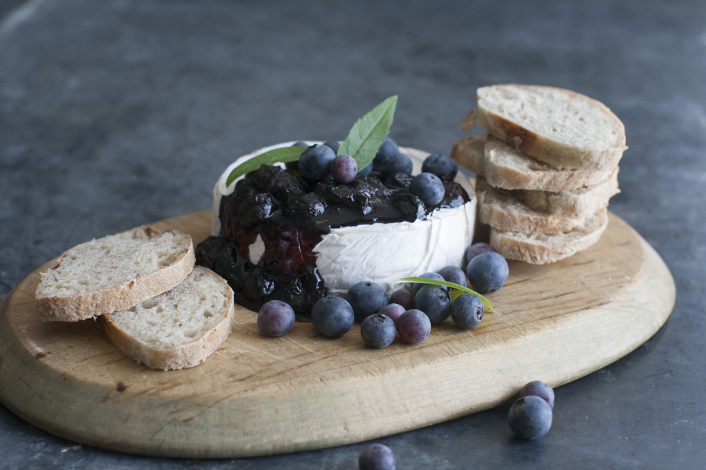 Blueberry topping over brie cheese.