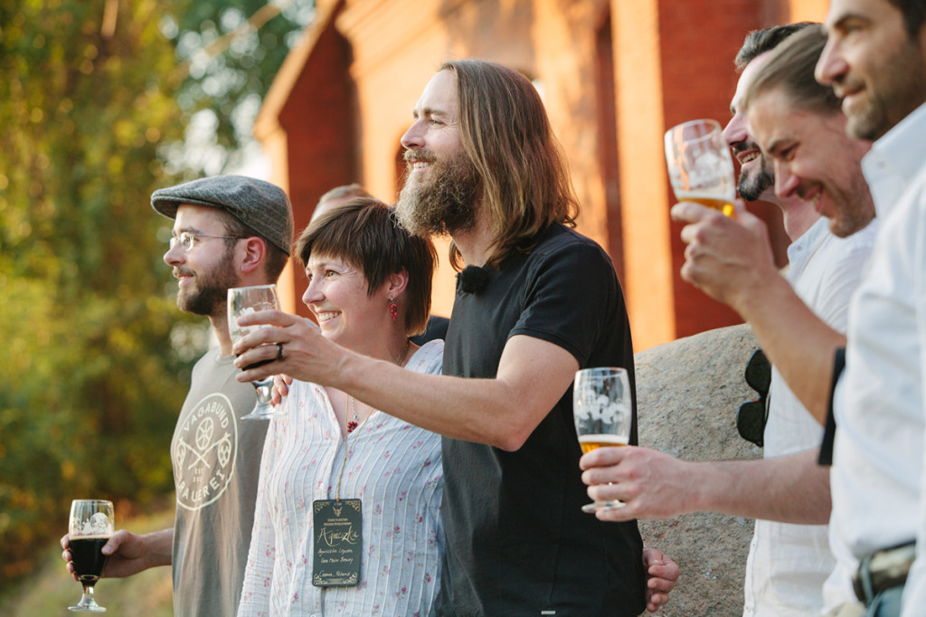 Stone Brewing Co. CEO and co-founder Greg Koch, center, toasts the crowd after announcing the Escondido, Calif., brewery's plan to build a brewery and bistro in Berlin. Stone Brewing Co. is spending about $25 million to renovate a historic gas works building into a brewery, packaging and distribution center, restaurant and garden set to open late next year.