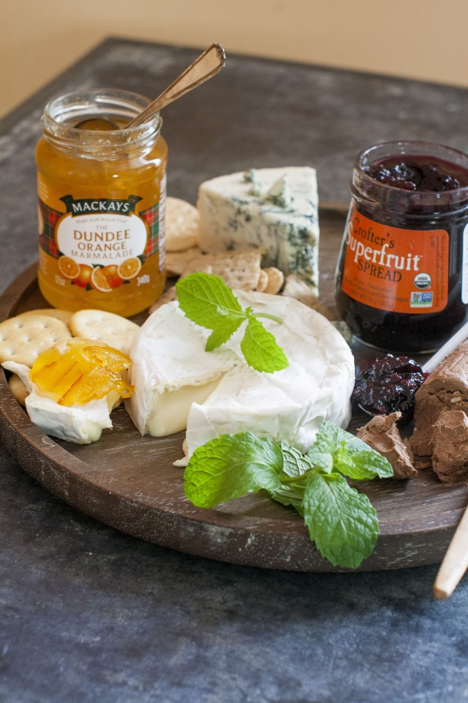 Cheeses with Mackays dundee orange marmalade, left, and Crofter's superfruit spread.