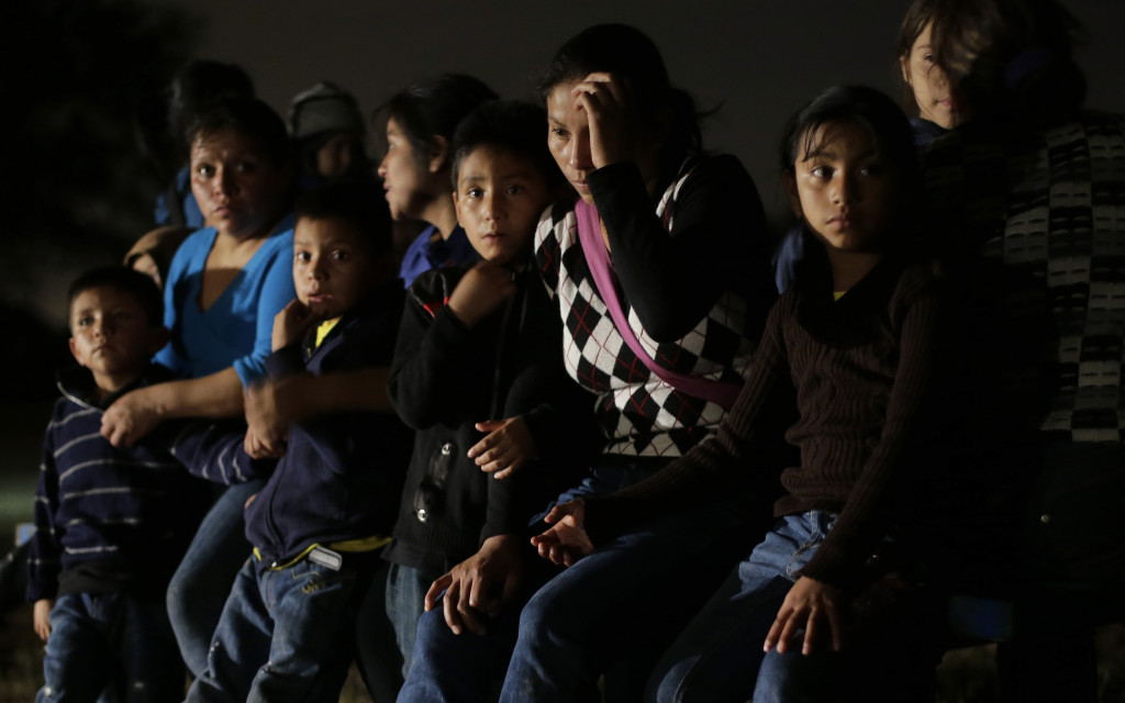 A group of  immigrants from Honduras and El Salvador who crossed the U.S.-Mexico border illegally are stopped in Granjeno, Texas, in this June 25, 2014, photo.  The Associated Press