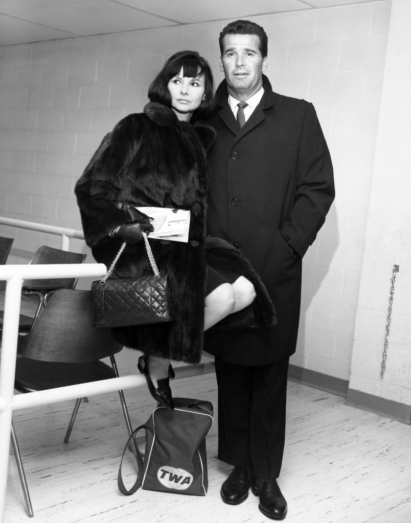 Actor James Garner, right, and his wife Lois are shown in the Trans World Flight Center prior to boarding a TWA Jetliner for London in this Feb. 21, 1964  photo taken in New York.  The Associated Press