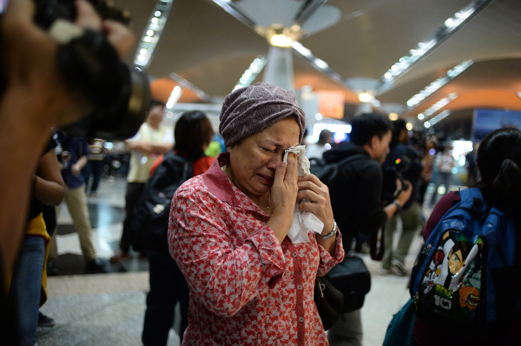 A woman reacts to news regarding a Malaysia Airlines plane that crashed in eastern Ukraine at Kuala Lumpur International Airport in Sepang, Malaysia, on Friday.