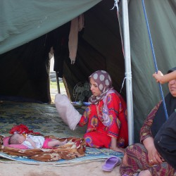 A displaced Iraqi family who fled from Baqouba after advances by Islamic militants, sits in their tent Sunday at a camp in Khanaqin, 90 miles northeast of Baghdad.