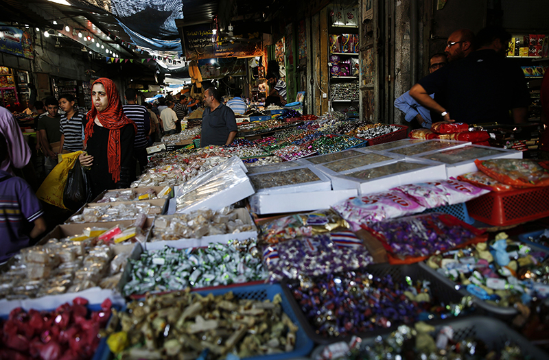 Palestinians flock to a market to buy foodstuff and other items during a 12-hour humanitarian cease-fire in Gaza, in the northern Gaza Strip, Saturday. The Associated Press