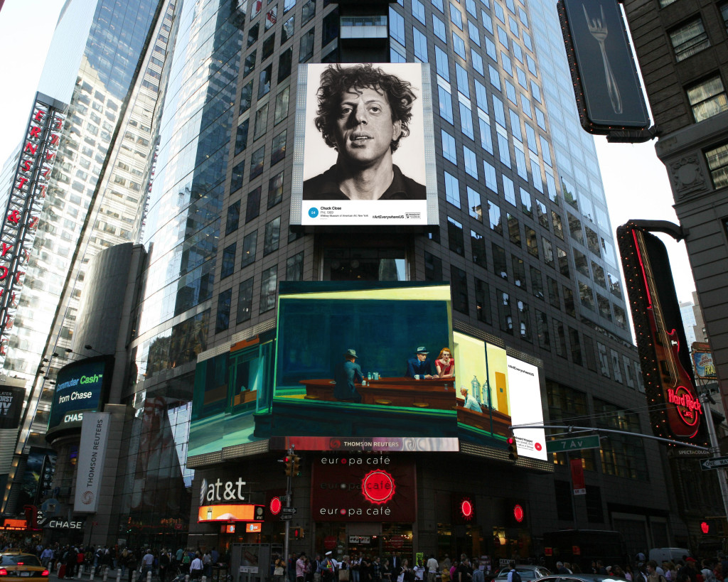 "This artist's rendering provided by Art Everywhere U shows, a display in New York's Times Square featuring Chuck Close's ""Phil,"" top, and Edward Hopper's ""Nighthawks."" Images of famous American artworks will appear on billboards, bus stops, digital display boards and subway platforms Aug. 4 through Aug. 31. The Associated Press"