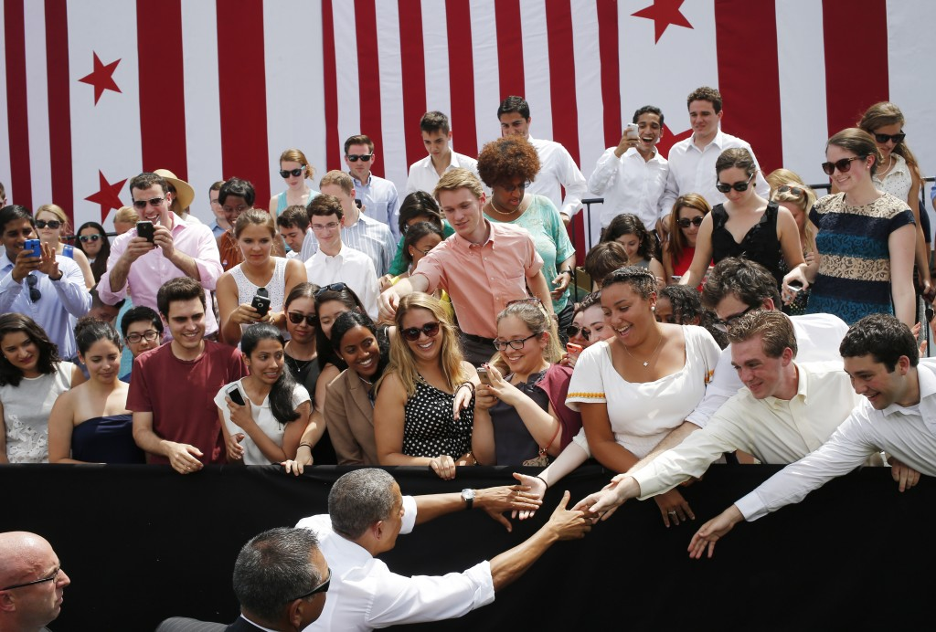 President Barack Obama greets audience members after he spoke about transportation and the economy at Georgetown Waterfront Park in Washington, Tuesday, July 1, 2014. Gridlock in Washington will lead to gridlock across the country if lawmakers can't quickly agree on how to pay for transportation programs, Obama administration officials warn. States will begin to feel the pain of cutbacks within weeks -- peak summer driving time.