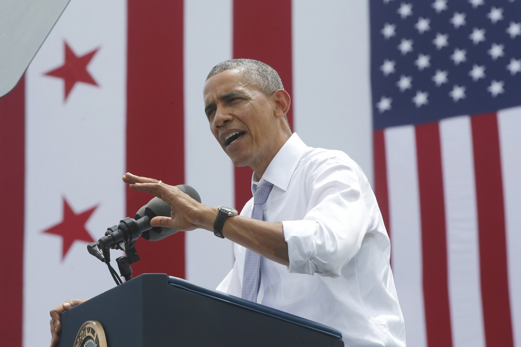 President Barack Obama speaks about transportation and the economy, Tuesday, July 1, 2014, at the Georgetown Waterfront Park in Washington. The president said 700,000 jobs could be at risk next year if Congress doesn't quickly agree on how to pay for highway and transit programs.