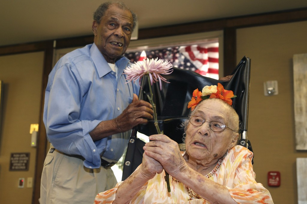Gertrude Weaver, right, talks with her son Joe Weaver, Thursday, July 3, 2014 at Silver Oaks Health and Rehabilitation Center in Camden, Ark., a day before her 116th birthday. The Gerontology Research Group says Weaver is the oldest person in the United States and second-oldest person in the world.