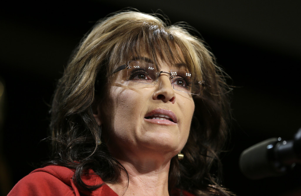 Former Alaska Gov. Sarah Palin speaks during a campaign rally in West Des Moines, Iowa., in this April 27, 2014, photo. Palin says she oversees all content posted to her new channel, which debuted Sunday.  The Associated Press