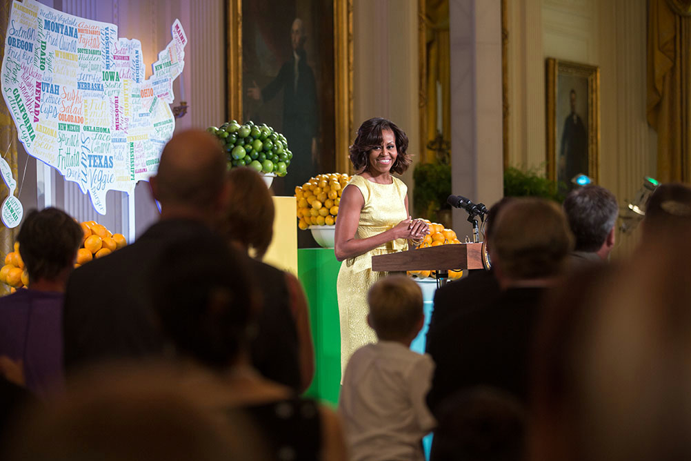 First Lady Michelle Obama delivers remarks and introduces President Barack Obama at the Kids' State Dinner in the East Room of the White House, July 9, 2013.