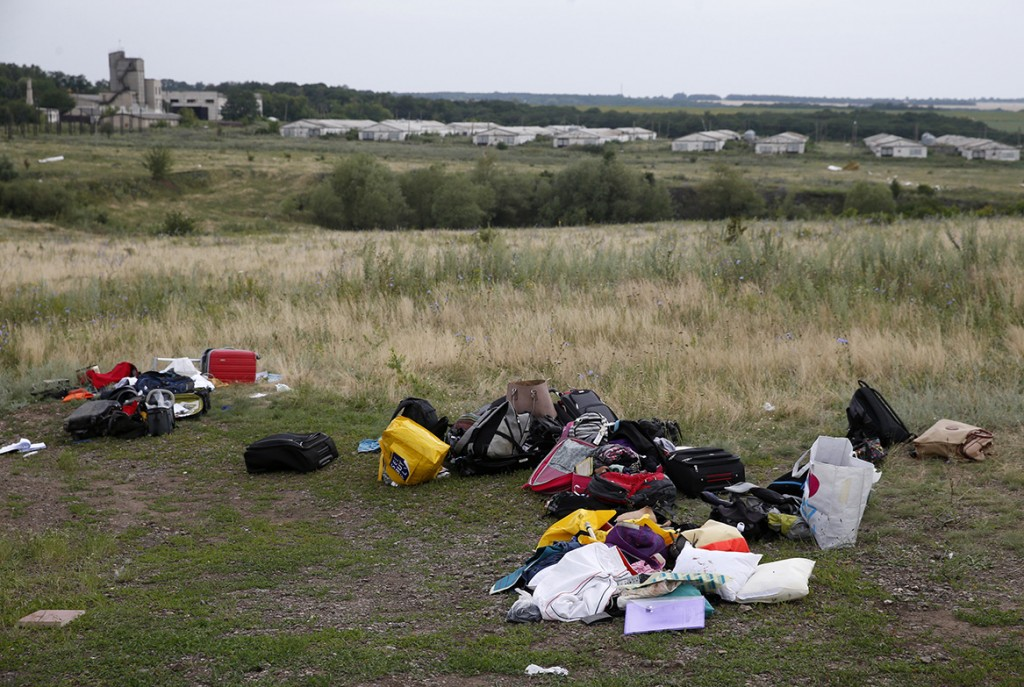 Luggage and belongings are seen near the site of Thursday's Malaysia Airlines Boeing 777 plane crash, near the settlement of Grabovo in the Donetsk region July 18.  World leaders demanded an international investigation into the shooting down of Malaysia Airlines Flight MH17 with 298 people on board over eastern Ukraine, as Kiev and Moscow blamed each other for a tragedy that stoked tensions between Russia and the West.