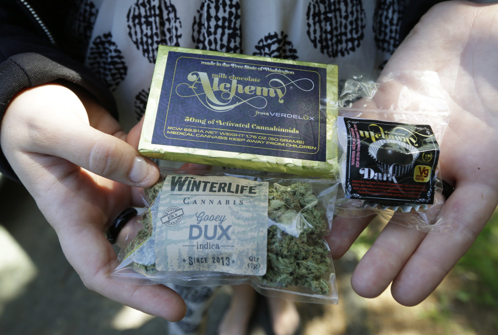 """A customer who identified herself as """"Tracy"""" displays marijuana, a pot-infused chocolate bar, and a marijuana truffle that she purchased outside her home from a pot delivery driver working for Winterlife."""