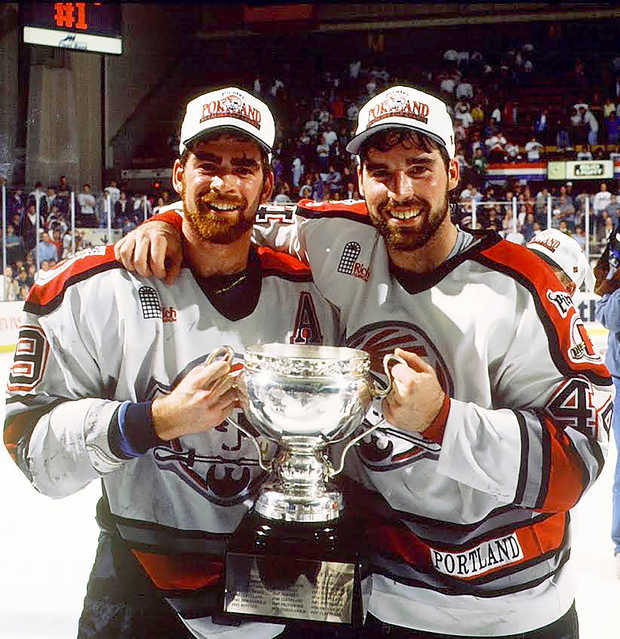 Brothers Jeff and Todd Nelson hoist the Calder Cup after the Portland Pirates won the American Hockey League title after the 1993-94 season, the team's first in Portland.