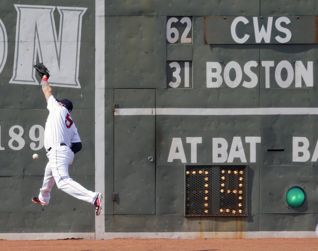 Red Sox left fielder Jonny Gomes leaps but can't make the play on a double by Chicago's Jose Abreu in the first inning Thursday.