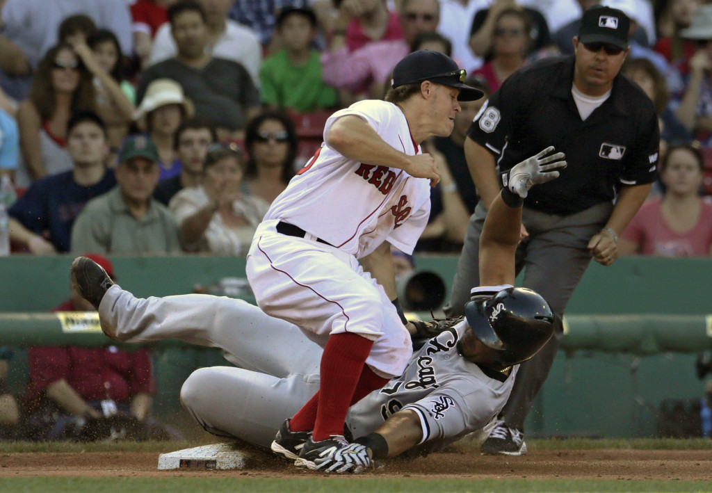 Red Sox third baseman Brock Holt makes the tag too late as the Chicago White Sox' Jose Abreu steals third base in the sixth inning Thursday.