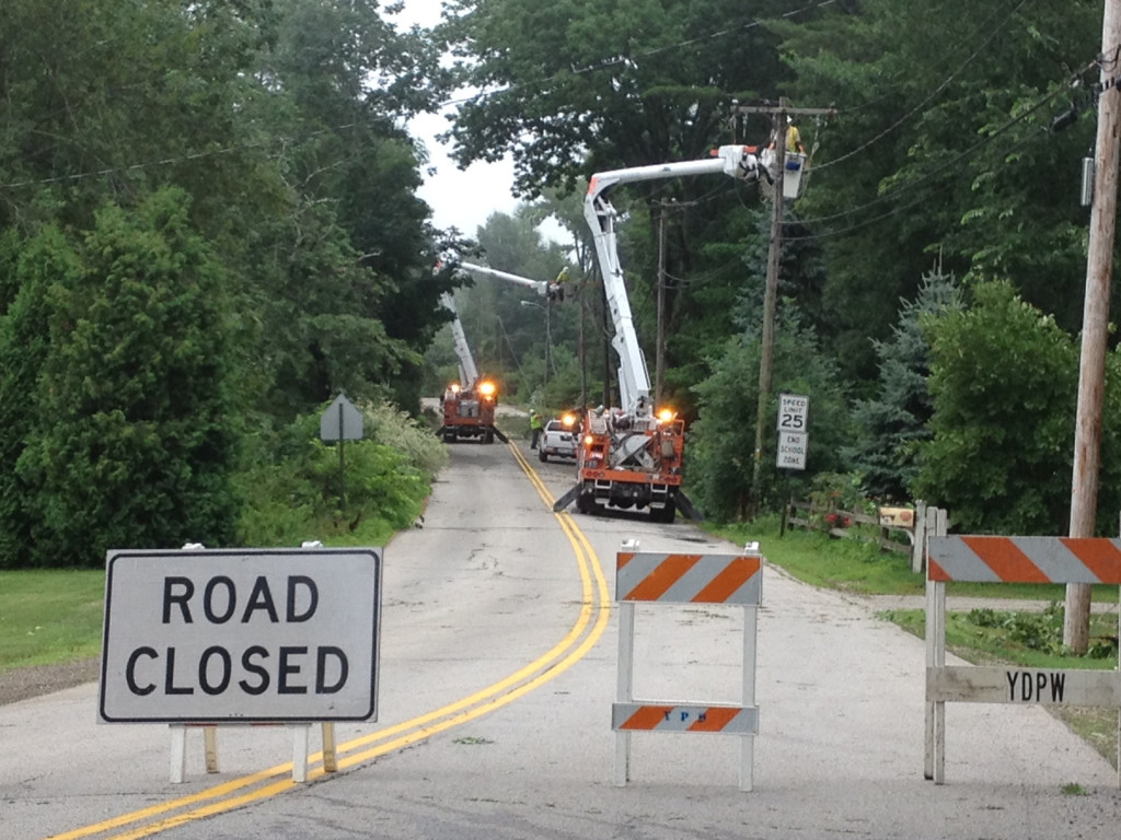 CMP crews work on power lines along Organug Road In York.