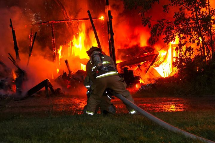 Firefighters in South Berwick battle a fire at a barn on York Woods Road that was hit by lightning Wednesday. Firefighters say lightning also caused a fire in a garage attached to a home on Emery's Bridge Road.