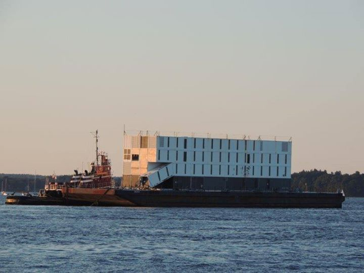 "The so-called Google barge, seen leaving Portland Harbor on Monday evening, is ""completely hollow inside,"" said Capt. Brian Fournier, whose Portland Tugboat LLC took the barge to Boston Harbor."